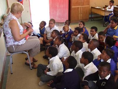 Lesgeven aan kinderen in Zuid-Afrika